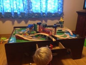 Godzilla and his train village.